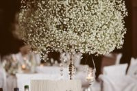 18 baby's breath ball centerpiece on a vintage holder