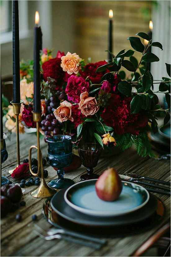 lush decadent flower centerpiece with hot pink and orange blooms for a boho lux tablescape