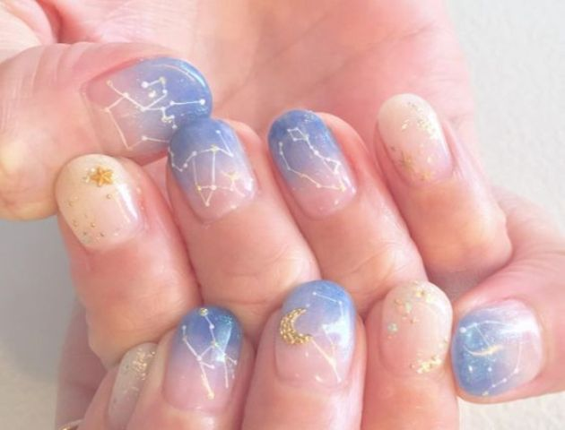 ombre blue and cream nails with constellations
