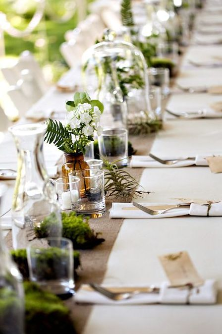 pieces of moss, air plants and greenery and blooms in jars