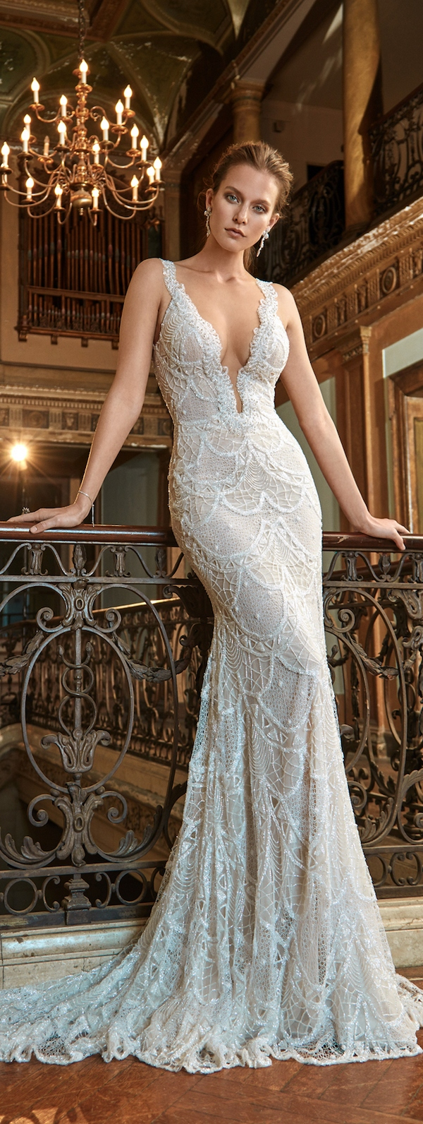 Textural Strap Fitting Wedding Dress With A Plunging Neckline And Appliques