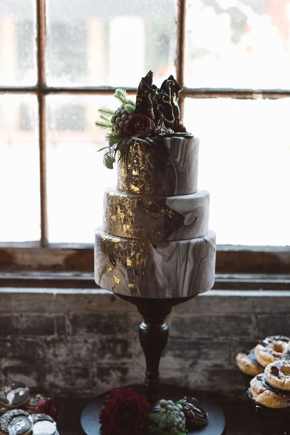 three-tier agate print wedding cake with gold detailing, fresh blooms and a chocolate topper