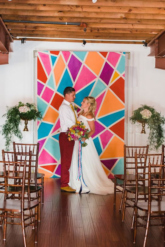 colorful paper geometric wedding backdrop to stand out