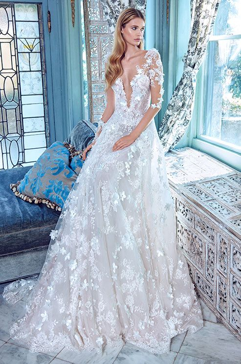 deep-V neckline, illusion sleeves and 3D floral appliques