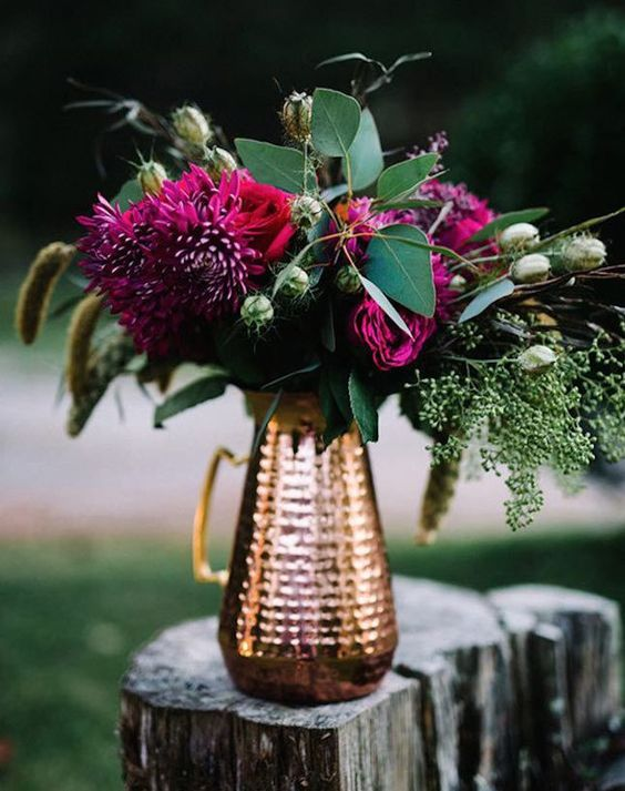 fuchsia and emerald wedding centerpiece in a copper pitcher
