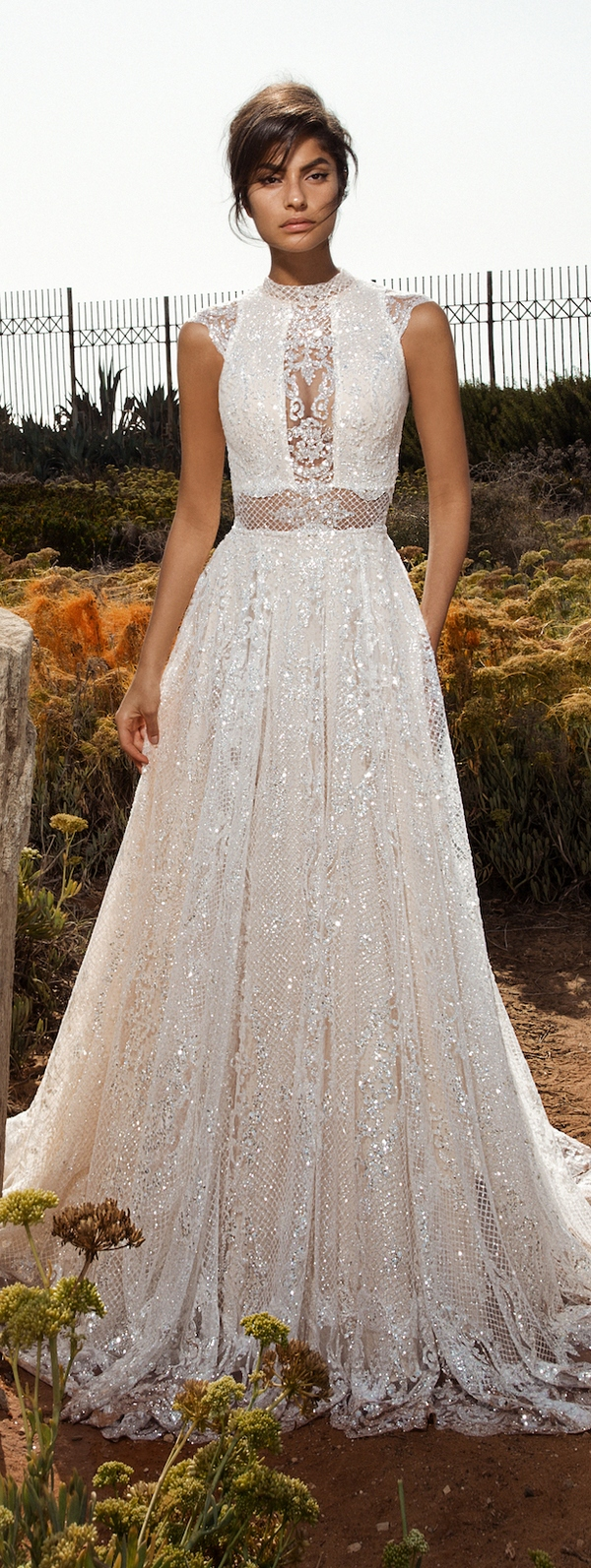 sparkling halter neckline border sleeve wedding dress with an illusion neckline and a sparkling textural skirt