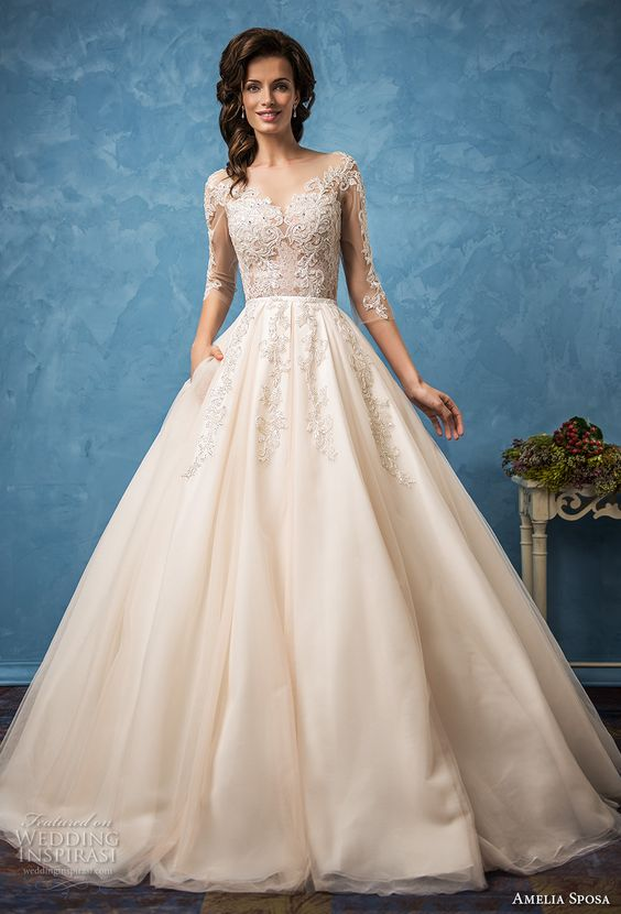 2379c820d2 champagne-colored wedding dress with an illusion lace bodice with sleeves  and lace appliques
