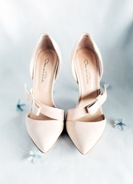 neutral wedding shoes with small bows on straps