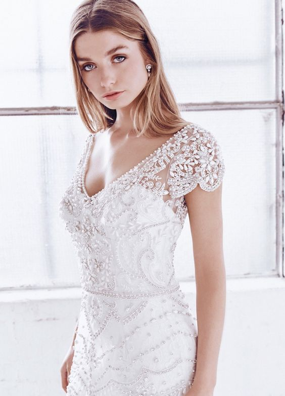 30 beautiful wedding dresses with cap sleeves weddingomania a heavily beaded art deco dress with a deep v neckline and cap sleeves junglespirit Choice Image