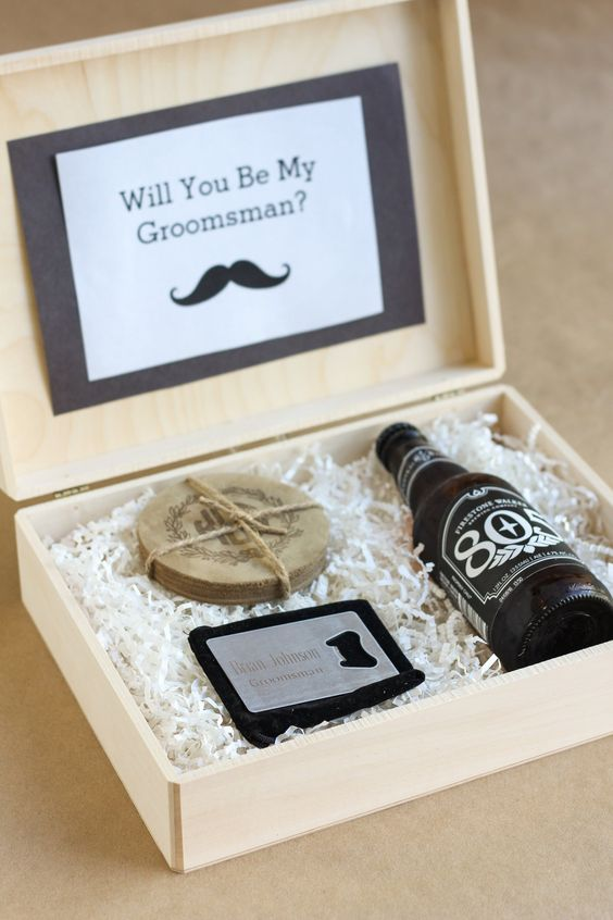 a wooden box with a beer bottle and coasters as a gift