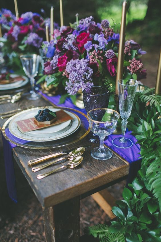 chic lilac, purple, blue and fuchsia flower table decor