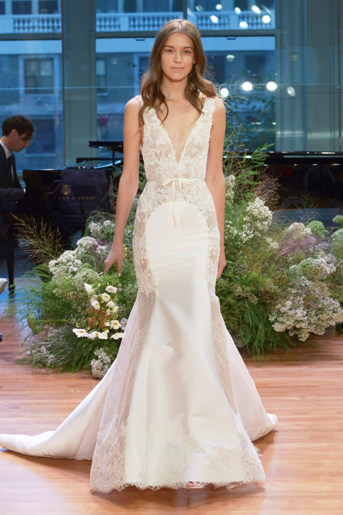 lace mermaid wedding dress with a plunging neckline and thick straps