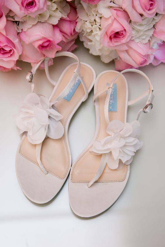 neutral suede wedding sandals with fabric flowers
