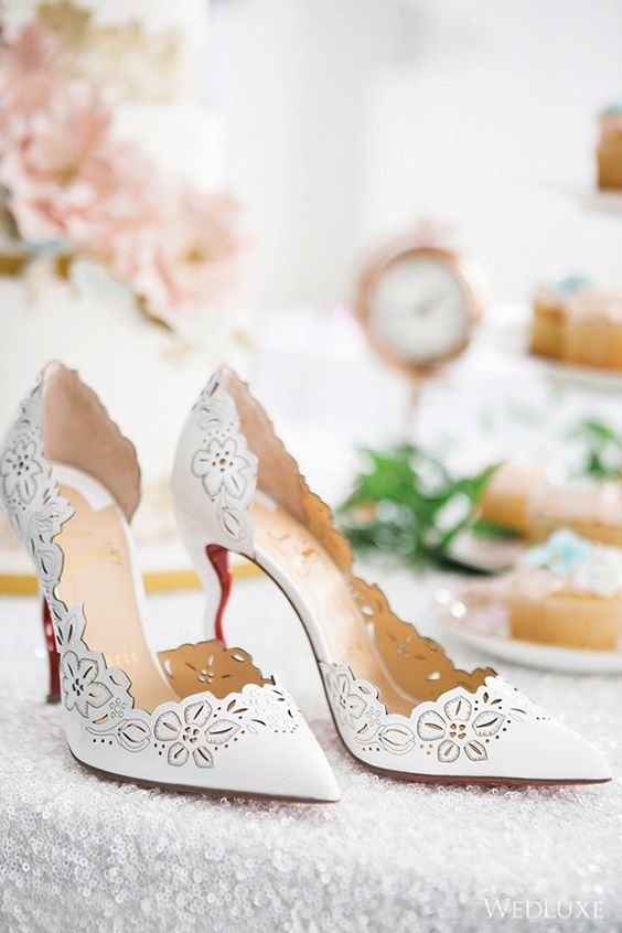 white laser cut heels with laser cut floral decor