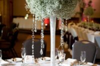 23 a large baby's breath ball on a glass stand with hanging crystals
