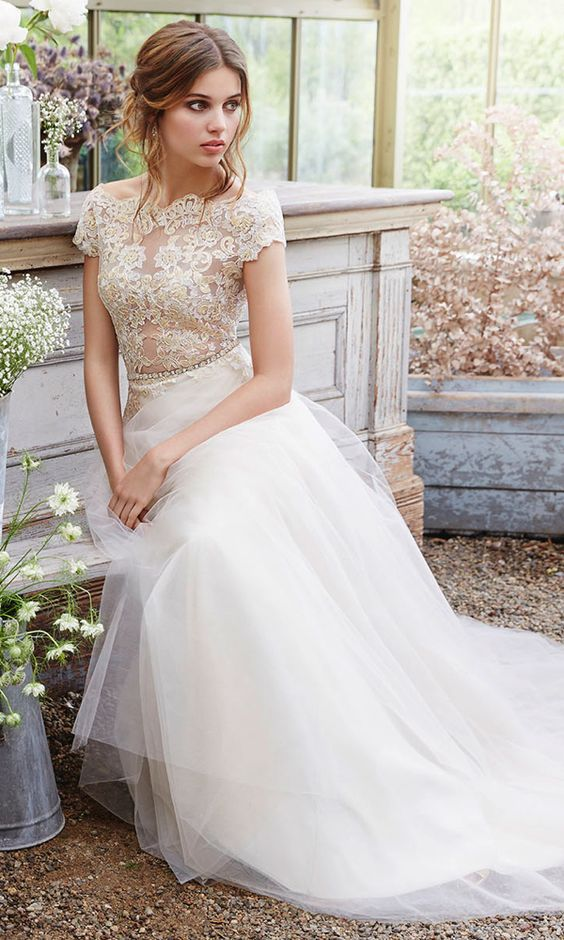 a romantic ivory wedding dress with a tulle skirt and a lace bodice with cap sleeves