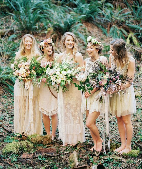 mismatching ivory lace gowns and floral crowns