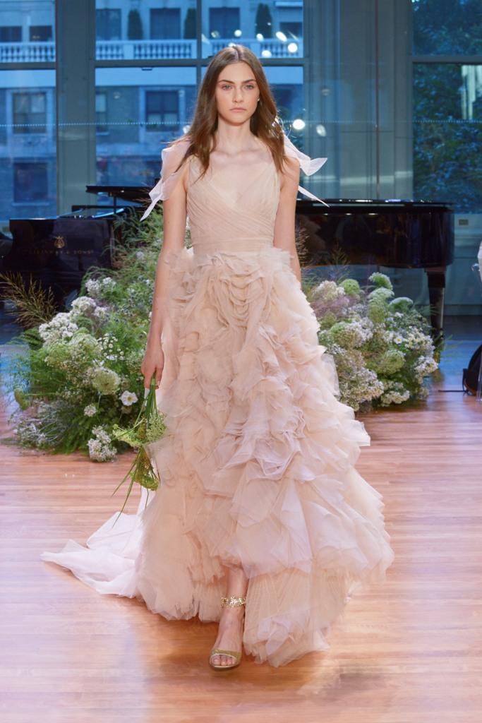 blush V neckline wedding dress with flowy sleeves and a ruffled skirt