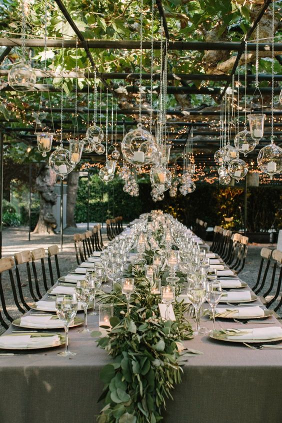 candle lanterns in spheric and drop shapes and lights over the reception