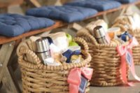 24 wicker baskets with a thermos and a hot drink inside and a pashmina to fight a cool ambience