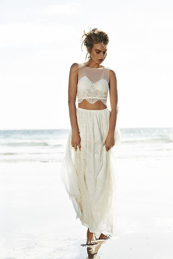 a flowy lace skirt and an illusion neckline crop top