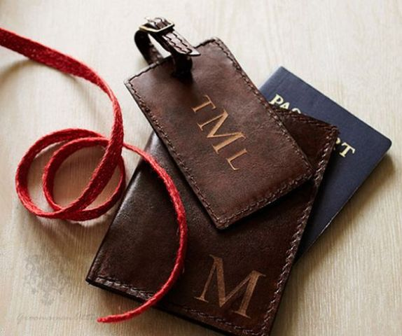 a leather luggage tag and a passport cover to pop up the question