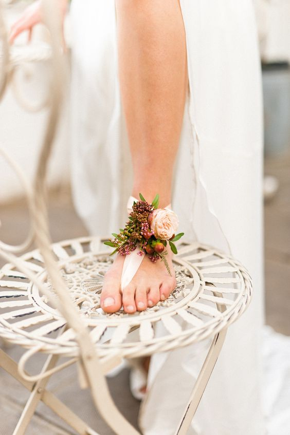 barefoot wedding sandals with fresh blooms and greenery for a garden bride