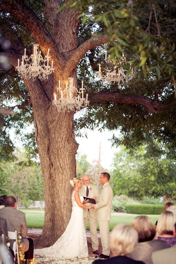 glam chandeliers over the ceremony space will add a chic touch