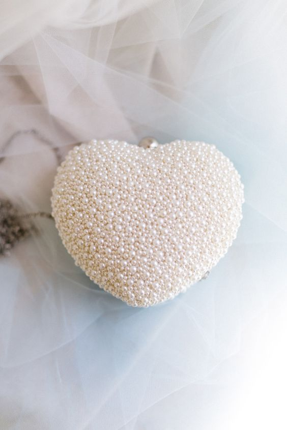 heart-shaped pearl bridal clutch is the cutest idea ever
