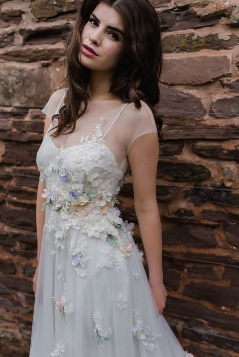 illusion neckline wedding dress with spaghetti straps and pastel floral lace appliques