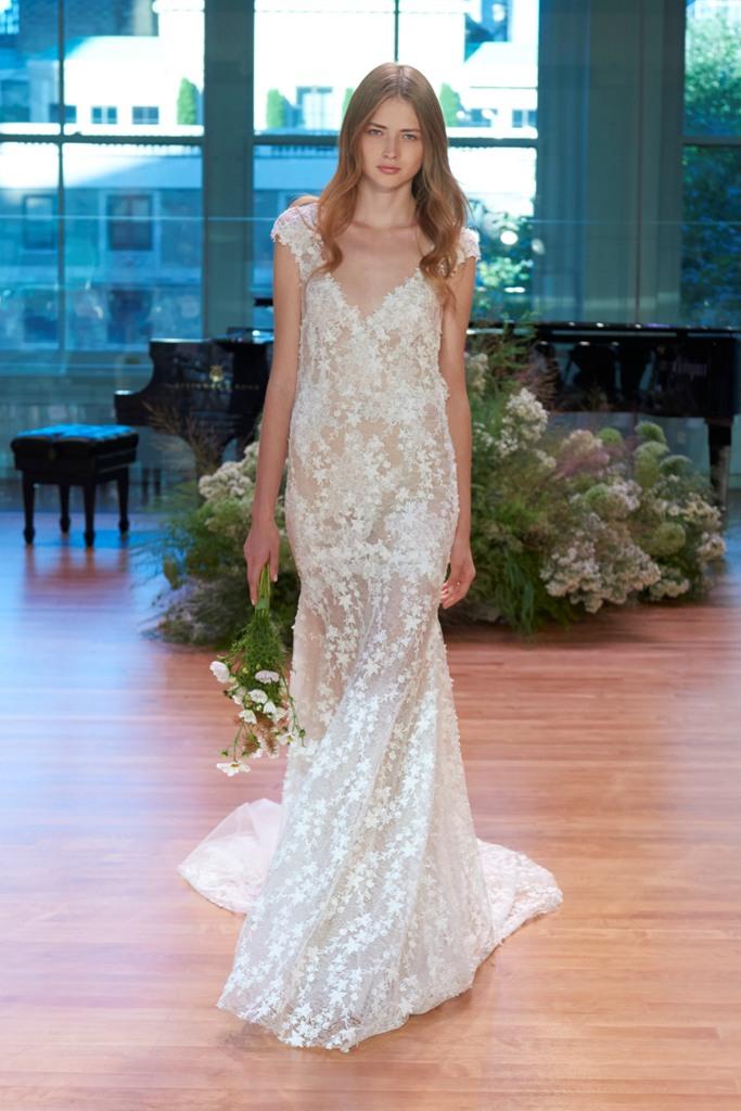 white floral applique thick strap wedding dress with a deep V neckline
