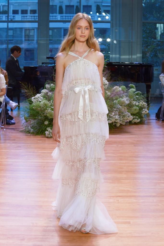 fringe boho-inspired layered wedding dress on straps with a bow