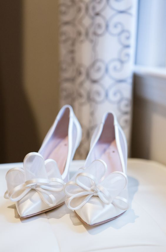 sheer white wedding shoes with oversized fabric bows