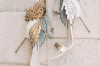 26 white and silver laser cut wedding shoes with wings decor