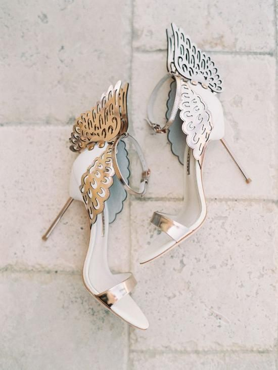 white and silver laser cut wedding shoes with wings decor