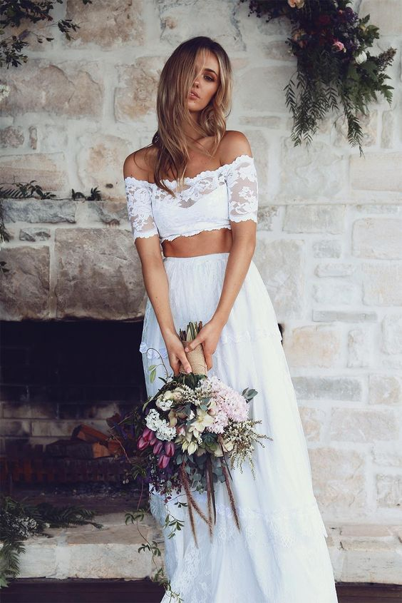 a lace off the shoulder crop top and a lace flowy skirt