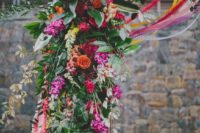 27 hot pink, red and orange flower arch decor with lush greenery