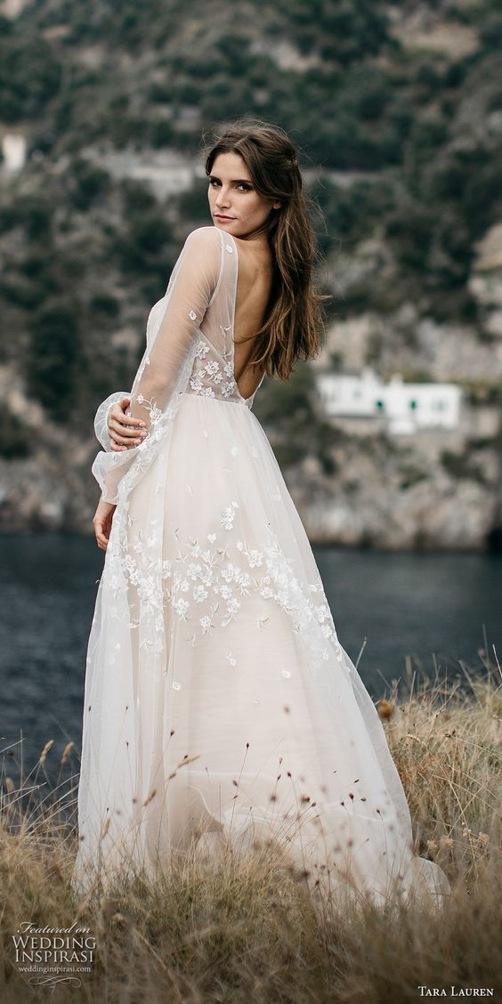 ivory wedidng dress with an illusion bodice, no back, sheer sleeves and floral appliques