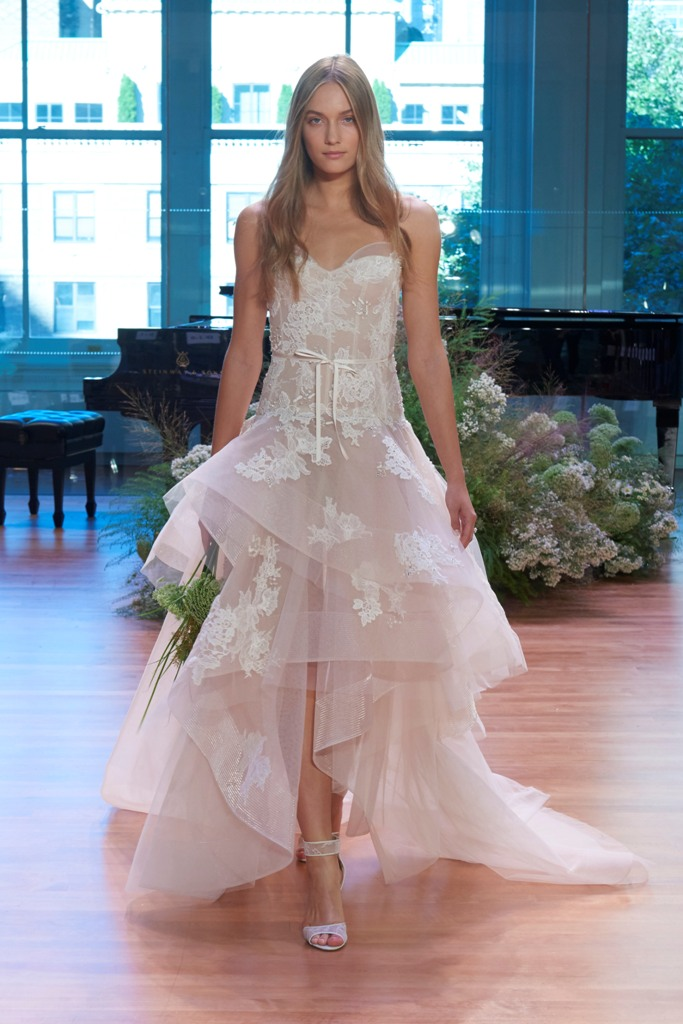 strapless blush high low wedding dress with a ruffled skirt and white lace appliques