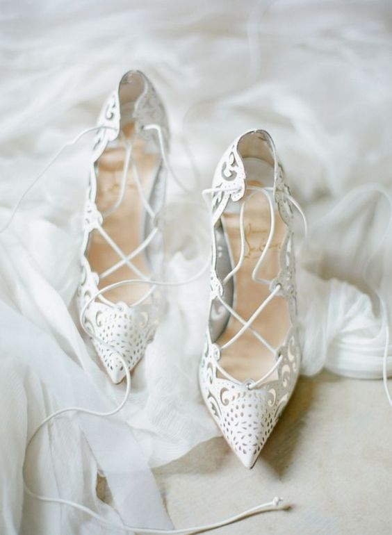 stunning white laser cut lace up heels for fashionable brides