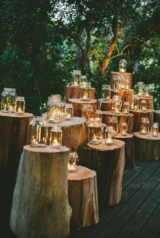 tree stumps wedding altar with candles in mason jars