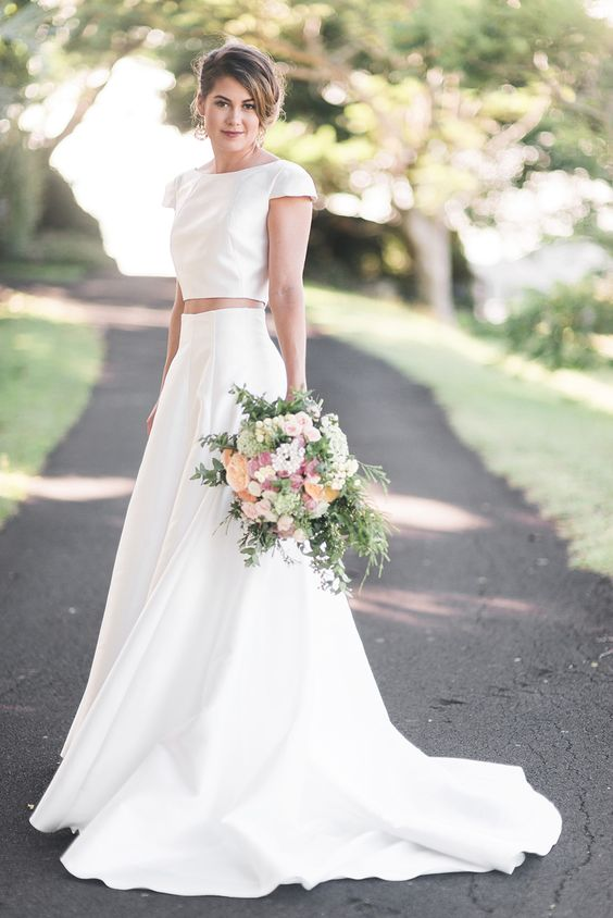 a modern plain two piece wedding dress with a train and cap sleeves