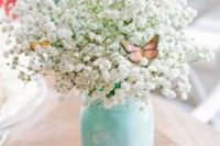28 aqua painted mason jar with baby's breath and faux butterflies for a dreamy look