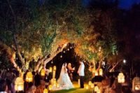 28 candle holders on the wedding arch and lanterns to line up the aisle