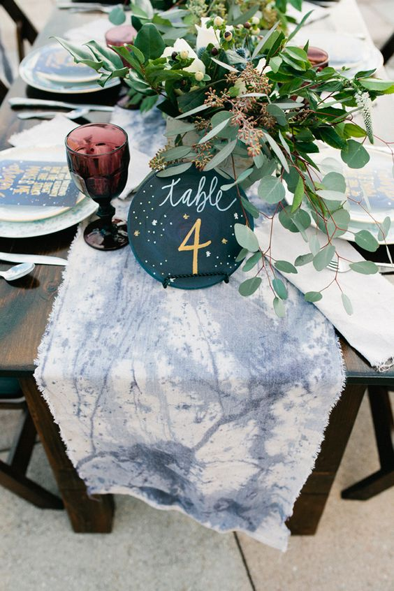 watercolor dyed constellation table runner and a table number