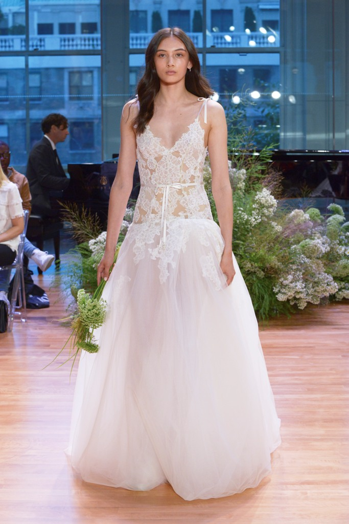 white lace bodice wedding dress with thin straps and bows on the shoulders