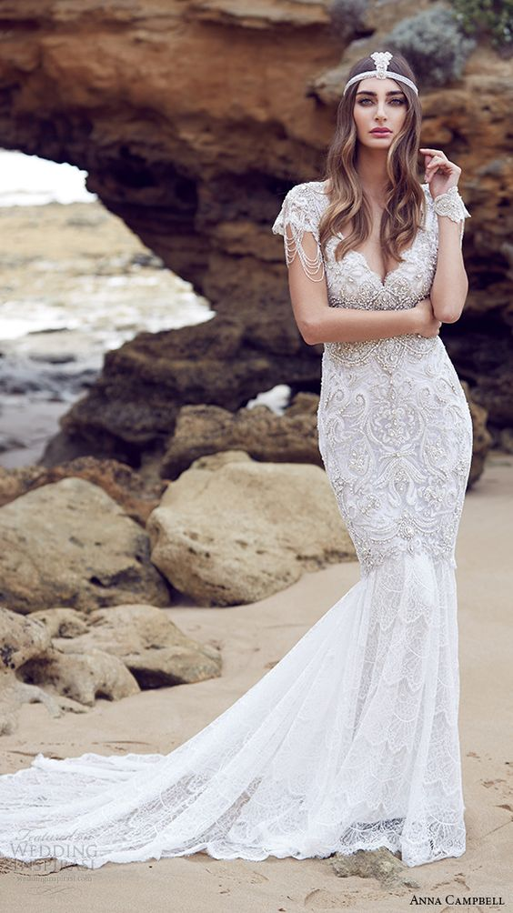 a boho wedding dress with a mermaid silhouette and heavy beading