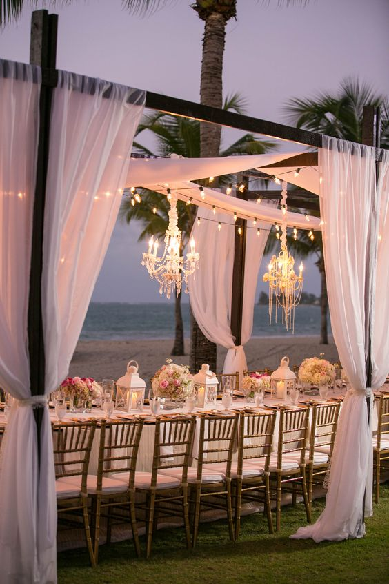 bulbs and glam chandeliers for a romantic beachside reception