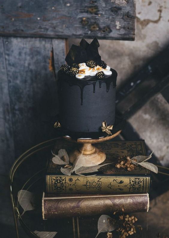matte black wedding cake with black dripping, cream, blackberries and dark chocolate