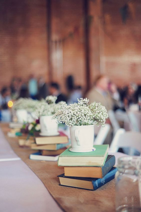 stacks of books with teacups and baby's breath